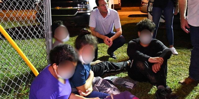 Rep. August Pfluger R-Texas, talks with migrants he encountered at the Texas-Mexico border on June 30, 2021.