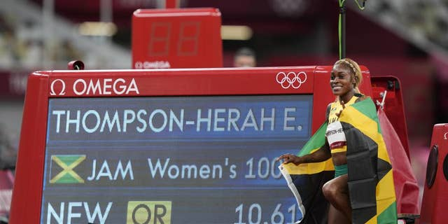 Elaine Thompson-Herah, of Jamaica, celebrates after winning the women's 100-meter final at the 2020 Summer Olympics, Saturday, July 31, 2021, in Tokyo. (AP Photo/Martin Meissner)