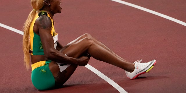 Elaine Thompson-Herah, of Jamaica, celebrates after winning the women's 100-meter final at the 2020 Summer Olympics, Saturday, July 31, 2021, in Tokyo. (AP Photo/Charlie Riedel)